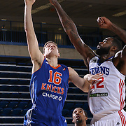 BYU alumni JIMMER FREDETTE (16) drives towards the basket as Delaware 87ers Forward EARL CLARK (22) defends in the first half of a NBA D-league regular season basketball game between the Delaware 87ers and the Westchester Knicks Tuesday, JAN, 19, 2016 at The Bob Carpenter Sports Convocation Center in Newark, DEL