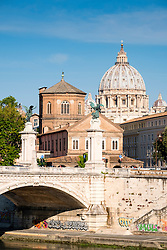view of the River Tiber, the Ponte Vittorio Emanuele II and St. Peter's Basilica in Vatican City Rome , Itlay