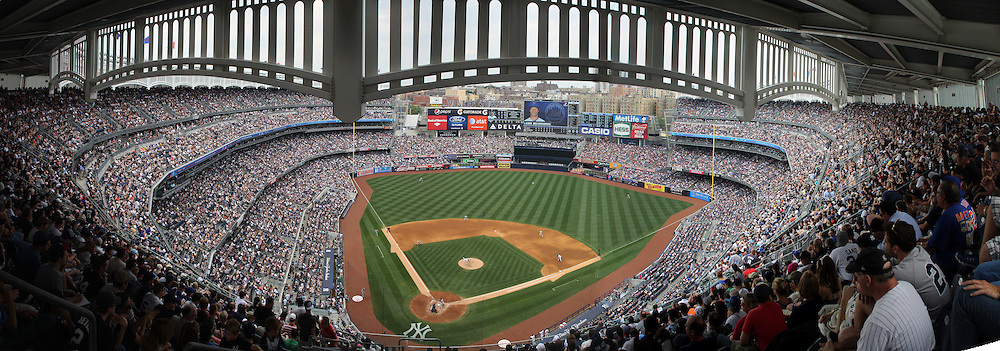 A panoramic view of Yankee Stadium during the New York Yankees V New York Mets Subway Series Baseball game at Yankee Stadium, The Bronx, New York. 10th June 2012. Photo Tim Clayton.Note to Editors. This image is a composite of three images taken a split second apart and merged in editing.