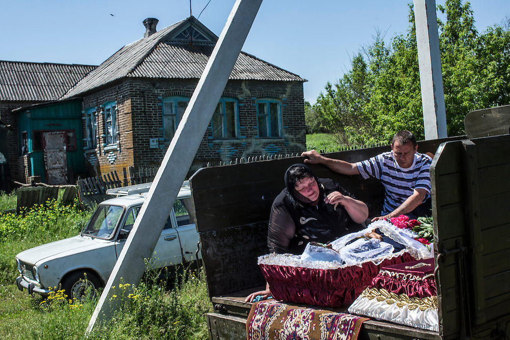 STAROVARVAROVKA, UKRAINE - MAY 16:  The casket of Elena Ott, 42, is carried from her family's house to the cemetery on May 16, 2014 in Starovarvarovka, Ukraine. Ott was killed two days prior when the car she was riding in was fired on by forces her family believes to be the Ukrainian military. (Photo by Brendan Hoffman/Getty Images) *** Local Caption ***