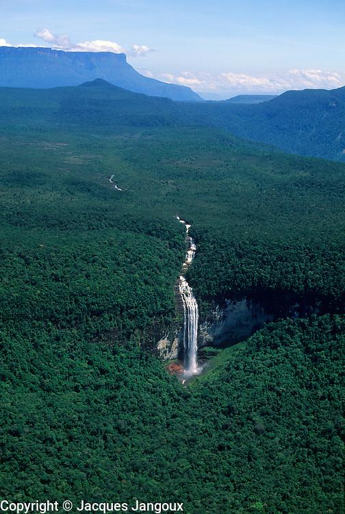 Waterfall coming down from Guyana (Guiana) Highlands toward Orinoco water basin, with tepui (table mountain) in background,  Guiana Shield,  Venezuela