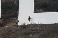 "Hollywood, CA. December 16th 2010 ***EXCLUSIVE*** Gwen Stafani films a commercial for L'Oréal at the ""L"" of the famous Hollywood Sign. Gwen's son Kingston was brought on to the set for a visit. Gwen snapped and then posed for posed for photos with son Kingston at the Sign. Later a remote controlled helicopter camera filmed shots of Gwen posing at the Sign. Photos by Eric Ford/On Location News 818-613-3955 info@onlocationnews.com"