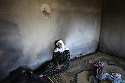 Old Grandmother Adiba sit in her house which was burnt during the latest army attack. The village of Bashirija which was beeing attacked by syrian Army in early April, leaving serveral people dead. Many houses were set on fire and livestock were shot dead by Assad loyal forces raging for two days. Later nighbours buried bodies of inhabitants hasty in a mass grave.