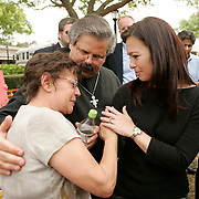 Suzanne Vitadamo (R), sister of the brain damaged Terri Schiavo, comforters a supporter of her sisters outside the front entrance to the Woodside Hospice on March 24, 2005 in Pinellas Park, Florida. REUTERS/Scott Audette