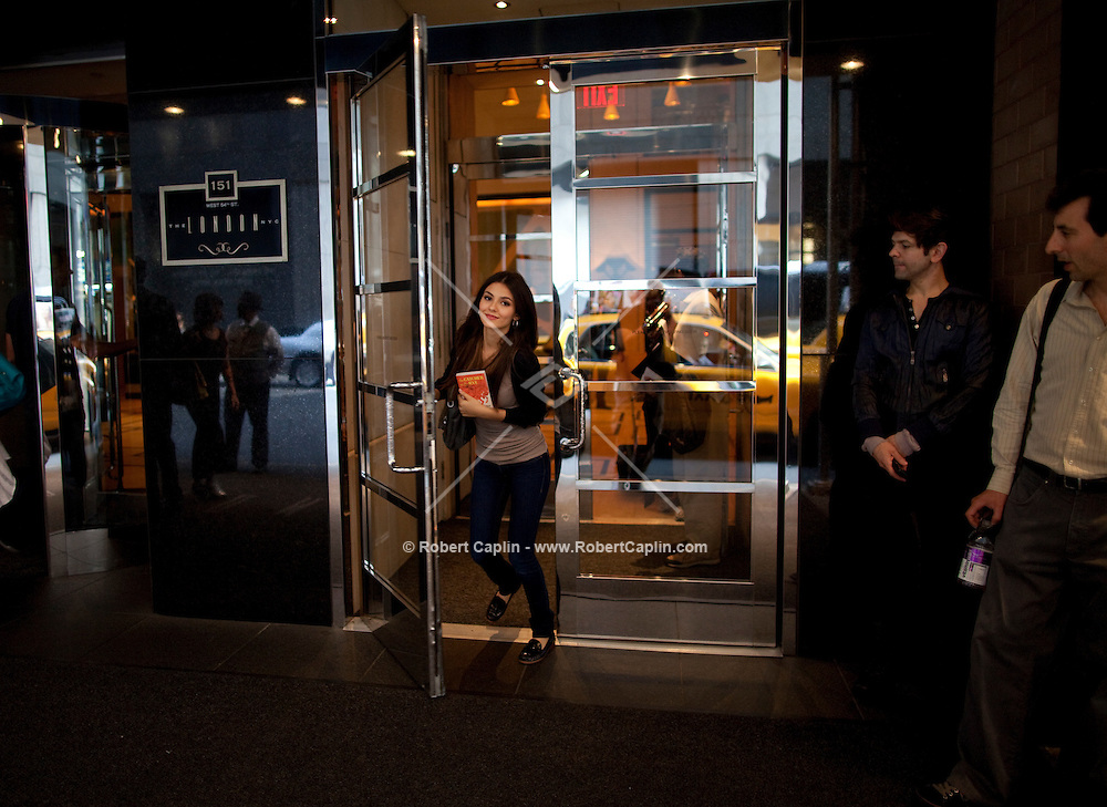 Actress and singer Victoria Justice leaves the London Hotel in route to the studios of The View in New York prior to performing on the show during Fall Fashion week 2011. ..Photo by Robert Caplin.