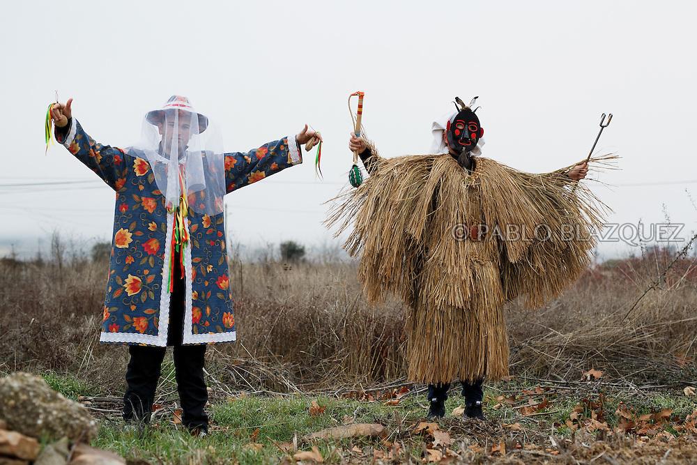 Men dressed as El Tafarron and La Madama pose for a portrait during El Tafarron festival on December 26, 2016 in Pozuelo de Tabara, Zamora province, Spain.  El tafarron is a pagan winter masquerade that takes place during Saint Esteban festivities. The festival is represented by El Tafarron and La Madama. El wears a custome of straw and a mask. (© Pablo Blazquez)