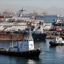 Ships are seen in the port of Piraeus in Greece on Feb. 20, 2008. Inspectors impose ITF-standard treaties on ship-owners to guarantee minimal standard working conditions for seafarers. They are on call 24 hours a day to address concerns from workers coming to port on the international ships.