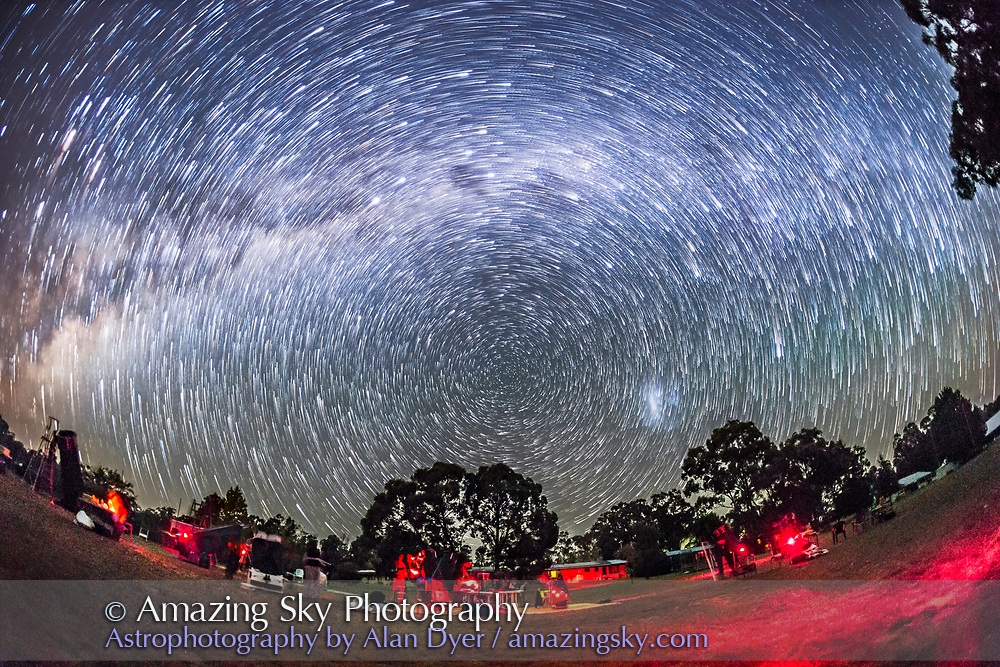 Circumpolar star trails over the OzSky star party near Coonabarabran, NSW, Australia, on April 3, 2016. This is a small annual star party attended by about 35 observers from around the world on a limited registration basis and put on by the Three Rivers Foundation in Australia. The view is looking due south here to the South Celestial Pole, with the southern Milky Way arching overhead, with Crux, the Southern Cross at top. The LMC is at bottom right. The field is filled with telescopes for observers to use to explore the wonders of the southern hemisphere sky. The stars are turning around the blank area that is the South Celestial Pole in Octans. This site is at a latitude of 32&deg; South. <br /> <br /> This is a stack of 49 frames, each 45 seconds at f/2.8 with the 15mm fish-eye lens on the Canon 6D at ISO 4000. The ground comes from three frames in the sequence. Stacked with Advanced Stacker Plus actions using Streaks mode.