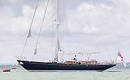 The yacht, Rita, owned by Olympic and America's Cup winning sailor, Sir Ben Ainslie, pictured on the opening day of Aberdeen Asset Management Cowes Week. The event began in in 1826 and plays a key part in the British sporting summer 'season'. It now stages up to 40 daily races for around 1,000 boats and is the largest sailing regatta of its kind in the world with 8,500 sailors competing.<br /> Picture date Saturday 2nd August, 2014.<br /> Picture by Christopher Ison. Contact +447544 044177 chris@christopherison.com