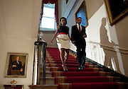 U.S. President Barack Obama and First Lady Michelle Obama arrive at a reception for ambassadors at the White House in Washington, D.C., U.S., Monday, July 27, 2009.    Photographer: Joshua Roberts/Bloomberg