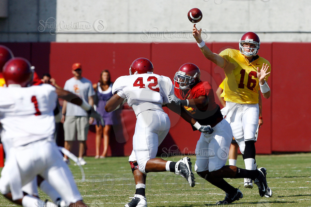 22 August 2009: QB #16 Mitch Mustain throws the ball during USC Trojans Pac-10 College Football team wrapped up Fall camp on Saturday infront of 1000 fans. The students start fall semester next week and prepare for their home opener in September.