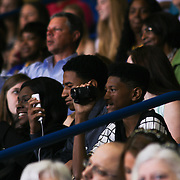 Family and friends takes photos during Alexis I. duPont High School commencement exercise Saturday, June 06, 2015, at The Bob Carpenter Sports Convocation Center in Newark, Delaware.