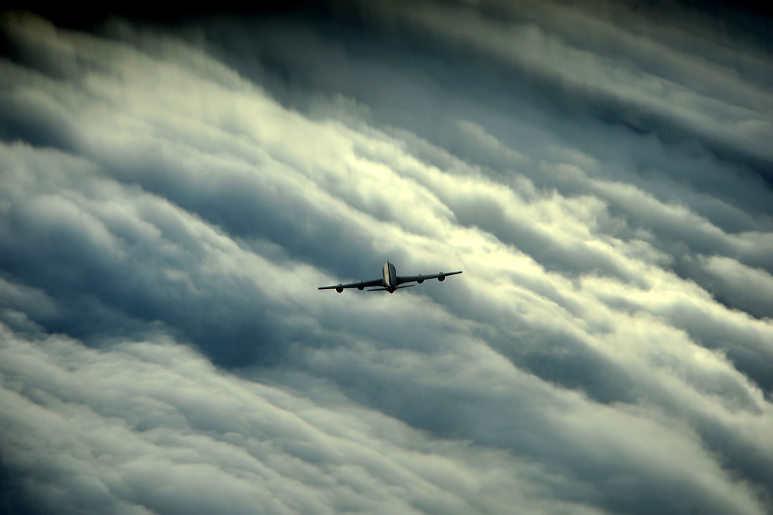 A KC-135 Stratotanker seems tiny in comparison to the huge storm its flying through on its way to refuel a C-17 Globemaster on July 12, 2012, off Florida's east coast. — © /
