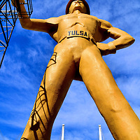 The Golden Driller Yellow Oil Man Statue in Tulsa, Oklahoma<br /> The world&rsquo;s tallest, free-standing statue is the 76 foot &ldquo;Golden Driller&rdquo; in Tulsa. This tribute to the once booming oil industry in Oklahoma was first created in 1953 for a petroleum exposition. This 1966 version of the 22 ton, yellow giant stands next to the Tulsa County Fairgrounds. His right hand rests on an actual oil derrick. His shoe size is 393DDD. The statue was commissioned by the Mid-Continent Supply Company of Fort Worth.