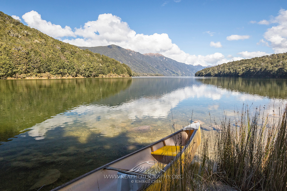 Shaped like a boomerang, Lake Monowai is one of the smaller glacial lakes in Fiordland National Park, New Zealand.