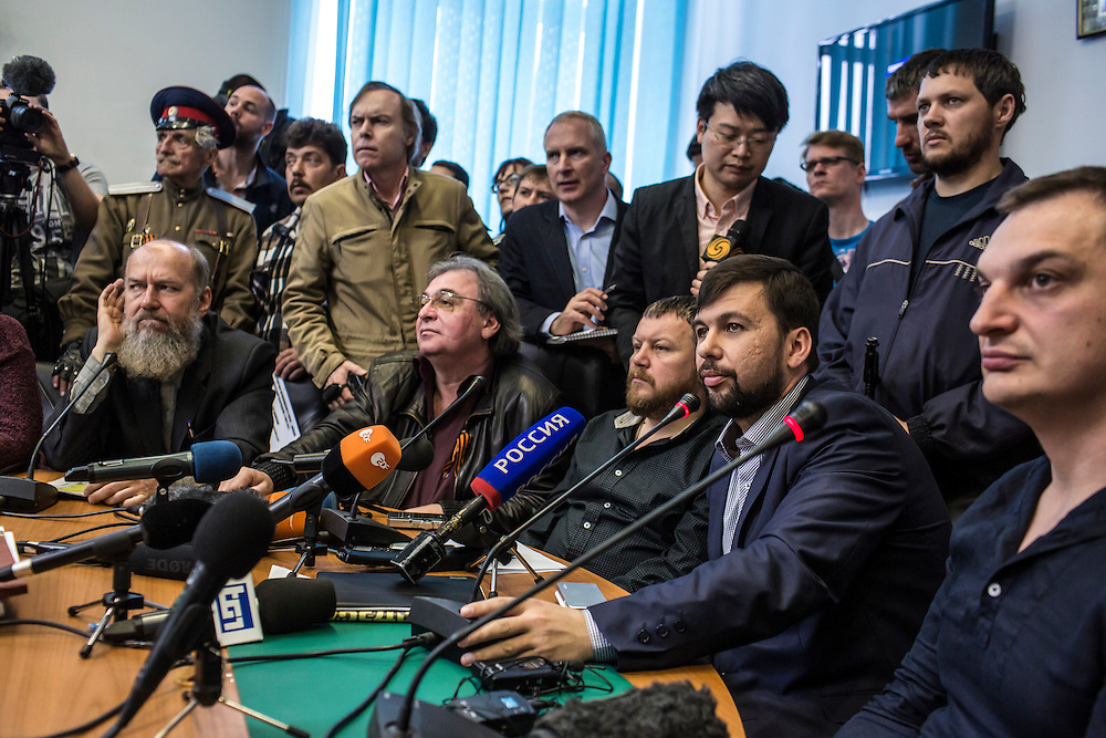 DONETSK, UKRAINE - MAY 8: Denis Pushilin (2nd R), the self-proclaimed chairman of the pro-Russian Donetsk People's Republic, holds a news conference to announce a planned referendum on greater autonomy from the central government in Kiev will go ahead on May 11 as scheduled on May 8, 2014 in Donetsk, Ukraine. Tensions in Eastern Ukraine are high after pro-Russian activists seized control of at least ten cities and ahead of the Victory Day holiday and a planned referendum on greater autonomy for the region. (Photo by Brendan Hoffman/Getty Images) *** Local Caption *** Denis Pushilin