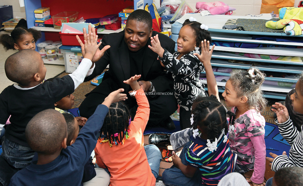 Father Urey Patrick Mark, a Society of the Divine Word priest and administrator of St. Nicholas Parish in North St. Louis, received high fives from the children at St. Nicholas Preschool during a visit there earlier this week.