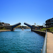 &quot;Walking Charlevoix&quot;<br /> I always enjoy walking the lovely  walkways in Charlevoix Michigan. This time the drawbridge opened for a boat to pass through. A beautiful sight on a beautiful day!