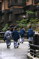 Out for a stroll in the streets of Kurokawa, onsen visitors regularly wear onsen yukata outside the onsen hotel before or after bathing.  Kurokawa Onsen is considered one of the most pleasant onsen towns in Kyushu for its lack of kitsch found at other watering holes.