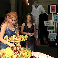 Claire Mc Dowell (left) and Colleen Judge, both from Oakwood enjoy a bite at the 2007 Arts Gala at Wright State University, Saturday evening.  The signs in the display behind them are some of the popular sayings during the 40 year history of WSU..
