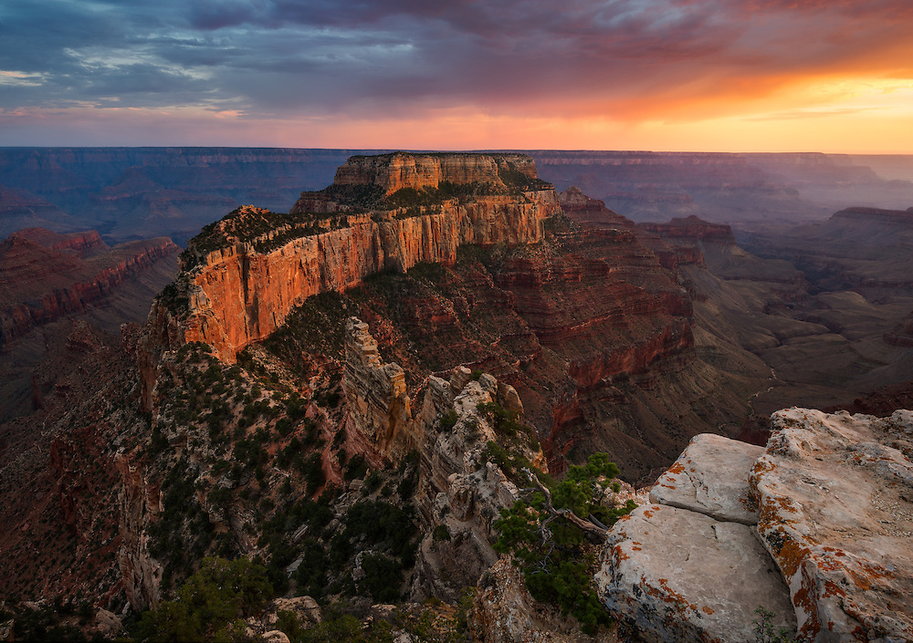Standing on the edge of Grand Canyon, looking across its great expanse to Wotan Throne as the sun sets. From Cape Royal on the North Rim of Grand Canyon National Park in Arizona.