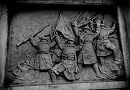 """Bronze relief of victorious Japanese soldiers shouting, """"banzai"""" after battle in China that has been mounted into a giant lantern on the approach to the controversial Yasukuni War Shrine where class A war criminals are enshrined with rank and file Imperial Army soldiers.  Tokyo, Japan.  Japanese politician visits to Yasukuni War Shrine inevitably result in protests by the governments of South Korea and China."""