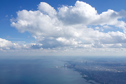 Aerial view of downtown Chicago in the summer while flying into ORD.