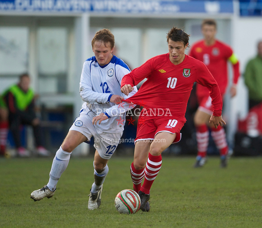 BRIDGEND, WALES - Monday, October 25, 2010: Wales' Billy Bodin in action against Kazakhstan's Igor Pikalkin during the UEFA Under-19 Championship Qualifying Group 1 match at Brewery Field. (Pic by: David Rawcliffe/Propaganda)