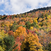 Pinkham Notch fall colors. Mount Washington is famous for dangerously erratic weather and one of the highest wind gusts ever measured at the Earth's surface, 231 mph (372 km/h or 103 m/s), in 1934. See Mount Washington (6288 ft, highest in northeast USA) above Pinkham Notch on Vermont Route 16, in the Presidential Range, White Mountain National Forest, New Hampshire, USA. The White Mountains (a range in the northern Appalachian Mountains) cover a quarter of the state of New Hampshire. Leaf peepers love the peak of autumn foliage around the first week of October.