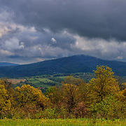 &quot;Life of a Storm&quot;<br /> <br /> Heavy storm clouds mixed with sun create deep blue shadows on mountains beyond!!<br /> <br /> The Blue Ridge Mountains by Rachel Cohen