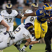 Delaware Running Back Andrew Pierce (30) carries the ball for 3 yards to WCU 37 and a first down during a Week 1 NCAA football game against West Chester. ..#15 Delaware defeated West Chester 41-21 in their home opener at Delaware Stadium Thursday Aug. 30, 2012 in Newark Delaware...Delaware will return home Sept. 8, 2012 at 3:30pm for a showdown with interstate Rival Delaware State in the Route 1 Rivalry Bowl at Delaware Stadium.