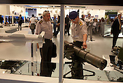 Two military officers from Ecuador admire an air-to-ground PARS 3 LR missile at the Paris Air Show, Le Bourget France