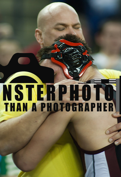 12/18/11 Newark DE: Ryan Wolfe of Carvel hugs his father Chadd Wolfe after defeating David Reck of Colonial Forge during the Beast of the East 182 pounds Finals Sunday Dec. 18, 2011 at The Bob Carpenter Center in Newark Delaware.<br /> <br /> Special to The News Journal/SAQUAN STIMPSON