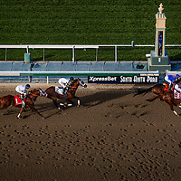 Game on Dude, ridden by Mike Smith battles with Hear The Ghost, ridden by Joel Rosario followed by  Mucho Macho Man, ridden by Gary Stevens and  Will Take Charge, ridden by Luis Saez during the Santa Anita Handicap (G1) at Santa Anita Park on March 8, 2014 in Arcadia, California (Photo by Evers/Eclipse Sportswire)\