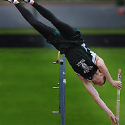 """Wilson's Brett McNeil brushes the bar but clears 15' 2"""" during the PIL track finals at Marshall HS. The height is a new track record and school record for Wilson."""