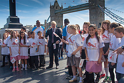 London, June 6th 2014. Mayor of London Boris Johnson and children from Alfred Salter Primary School welcome the Commonwealth GamesQueen's Baton Relay to the Capital.