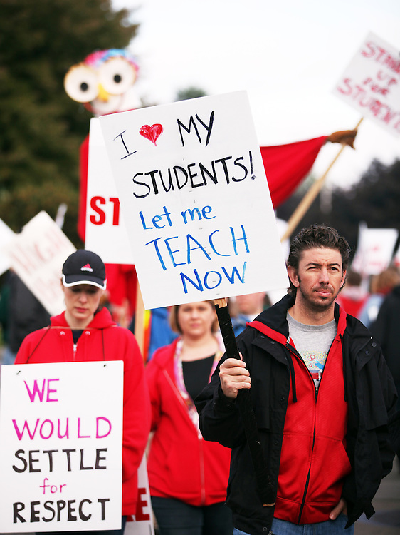 Teachers and staff go on strike at Reynolds High School on Friday, May 25, 2012.