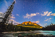 The autumn stars of Pegasus and Andromeda, with the Andromeda Galaxy above centre, over the Athabasca River and Mt. Kerkeslin, at Athabasca Falls, Jasper National Park. Moonlight from a low waxing Moon provides the illumination. This is a single exposure, 60 seconds at f/2.8 with the Rokinon 14mm lens and Canon 5D MkII at ISO 3200.