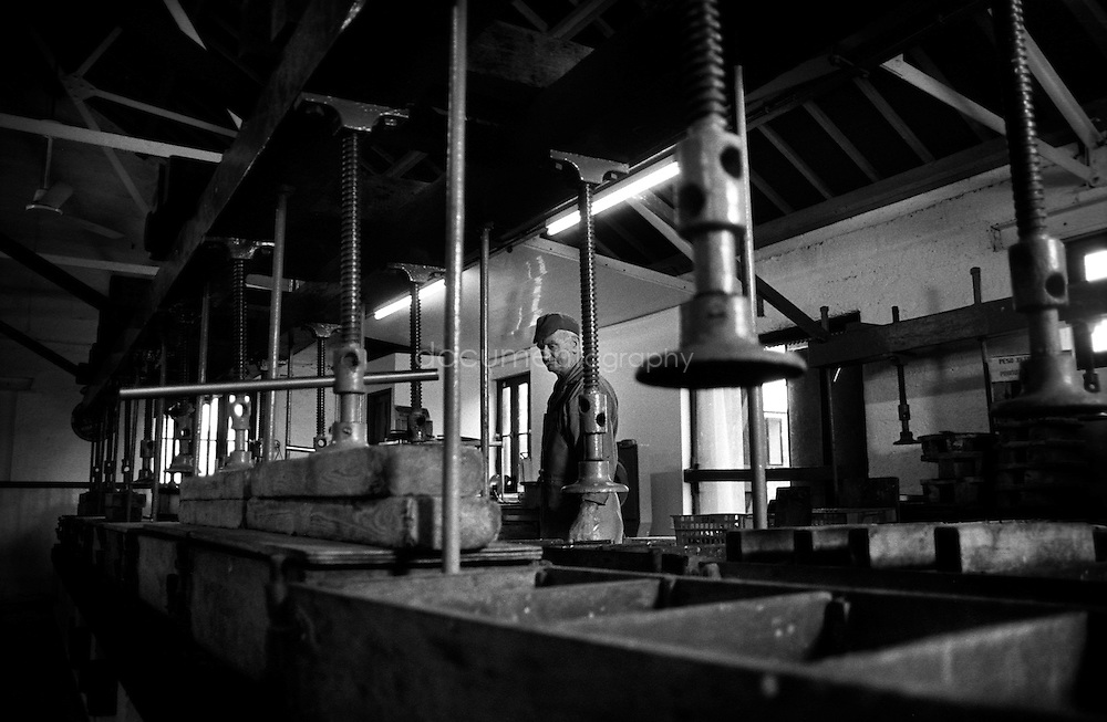 Terry (73) near the traditional presses used to flatten the fish and squeeze to salted oil out of them. It is with great regret that Terry will retire when the Pilchards Works closes.