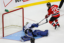 Nov 5, 2008; Newark, NJ, USA; New Jersey Devils left wing Patrik Elias (26) scores against Tampa Bay Lightning goalie Mike Smith (41) during the overtime period at the Prudential Center. The Devils defeated the Lightning 4-3 in an OT shootout.