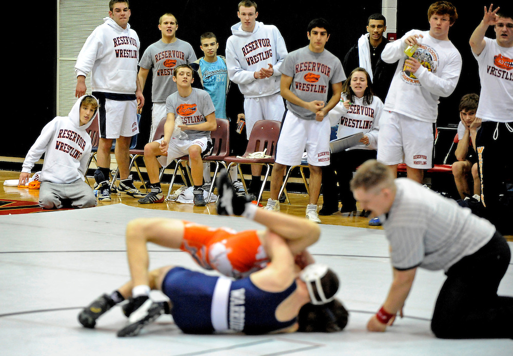 (staff photo by Matt Roth)<br /> <br /> Tension run high on the Gator's bench. All David Kuper had to do was not get pinned and the Gators would win the State Duals title. The other thing Kuper had to do was not let La Plata's Dan Brannon win by technical fall. Of course, at the five minute mark, Brannon won, 15-0, effectively tying the contest. A moment of tension was cut after an extra point was awarded to Reservoir because they had three pins over La Plata's two. <br /> <br /> Reservior High School beat La Plata 32-31 to win the 3A/4A State Duals Championships held at North County High School Tuesday, February 23, 2010.