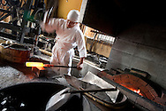 Sadanori Tanaka, a swordsmith for 18 years, works on a sword in his forge, in Komuro, Chiba-ken, Japan, Wednesday 27th May 2009. Tanaka-san was working on the folding and re-folding the block of steel, which merges the areas of soft and hard metals, prior to shaping the metal block into a sword length.