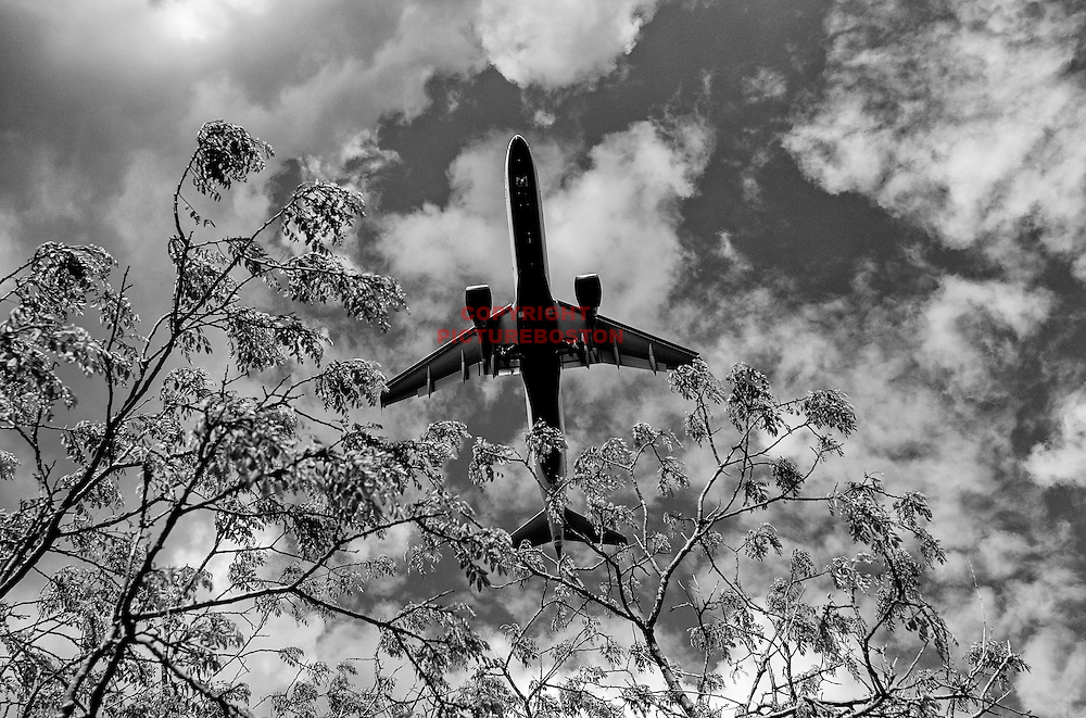 A jet makes its approach to Logan airport.