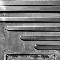 Detail of the stainless steel trim on the front of an old municipal bus