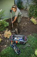 B.J. Schlieder, of Shaw Plumbing, fixes a broken pipe on Cedar Street in Calistoga