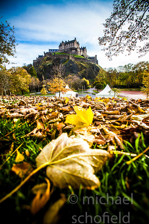 Edinburgh Castle seen from the leaves on Princes Street Gardens..©Michael Schofield.