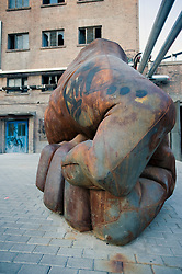 Sculpture of clenched hand at the 798 Art District at Dashanzi in Beijing China
