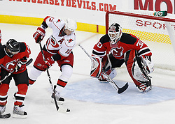 Apr 23, 2009; Newark, NJ, USA; Carolina Hurricanes center Eric Staal (12) takes a shot on New Jersey Devils goalie Martin Brodeur (30) during the third period of game five of the eastern conference quarterfinals of the 2009 Stanley Cup playoffs at the Prudential Center. The Devils beat the Hurricanes 1-0 to take a 3-2 lead in the best of 7 series.