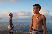 Portrait of a local island lad during the late afternoon scene on Sugar Dock, on the beach in Saipan. The beach and dock is a popular local swimming and party spot on the island.