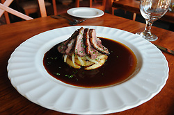Ken Duckworth, chef of Duckworth's Bistrot on East Main Street in Gloucester, offers a pan-seared duck breast with sauteed apples, fennel and a sweet and sour apple cider sauce. Also a pictured is a wild mushroom soup with sauteed mushrooms..Photo by Mike Dean